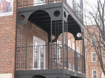 Image of finished steel balcony in black.