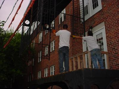 Image of piece of balcony being lowered into place.
